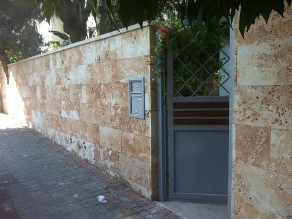 חיפוי אבן מסוטטת חומה וילה ברחובות